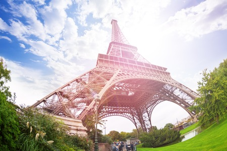 wide angle lens: Eiffel Tower in Paris from low angle and wide angle lens at the beautiful sunny autumn day