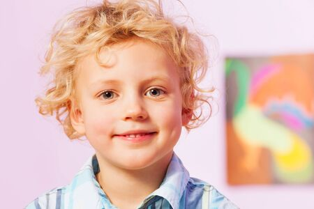 blond boy: Handsome boy with curly blond hairs in the room