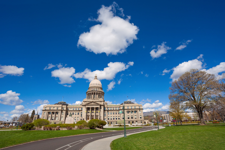 Boise Capitol building over blue sky with small white clouds