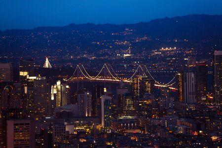 bay bridge: Oakland Bay Bridge in San Francisco during the night over city downtown