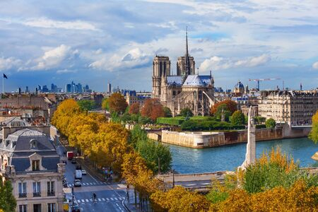 Sienna river and Notre dame cathedral in Paris and panorama of city from roof of another building Stock Photo