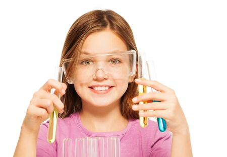 blinkers: One smiling Caucasian schoolgirl in safe eyewear with three test tubes in her hand isolated on white Stock Photo