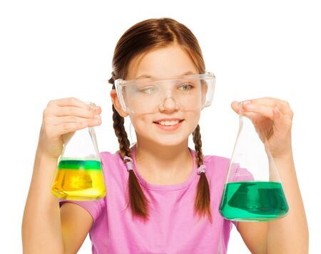 blinkers: One Caucasian schoolgirl with two flasks filled with liquid reactant in safe eyewear isolated on white