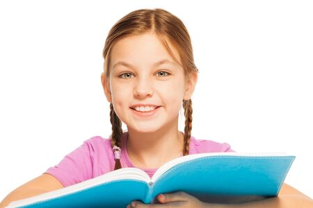 fair haired: One clever smiling schoolgirl with a textbook in her hands is listening important lesson