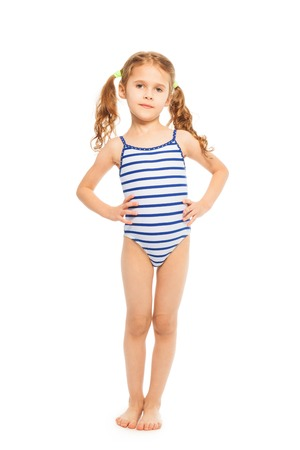 Little model standing full length in stripped swimming suit isolated on white