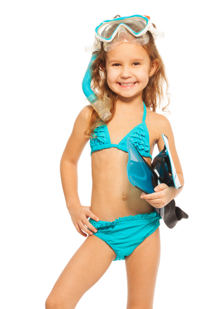 Smiling girl in blue swimwear with flippers, snorkel and diving mask isolated on white