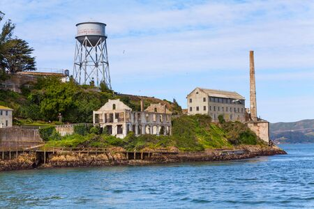 infamous: Ruins of buildings in Alcatraz and water tower California, USA Stock Photo