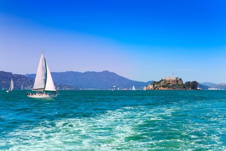 sf: View of San Francisco bay with with yachts sail and Alcatraz prison on background