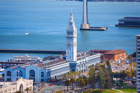 san francisco: Ferry port pier tower building in San Francisco view from the hill