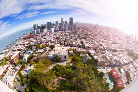 Fisheye view of San Francisco panorama skyscrapers and houses from the hill shot with wide angle lens