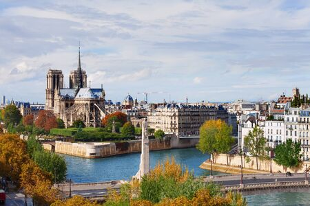 Scenic view of Notre Dame de Paris with Saint-Louis and Cite islands on a bright autumn day Stock Photo