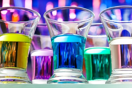 in low spirits: Set of many color alcohol drinks in shoots from bellow