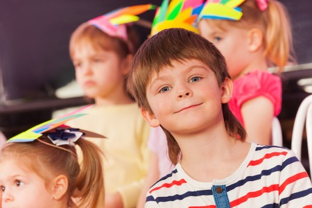children at play: Portrait of smiling surprised little boy with his friends and mates from class
