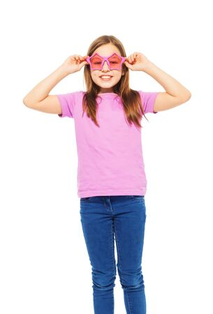 rose coloured: Tall harmonious girl wearing funny pink glasses and t-shirt isolated on white