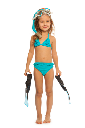 swimming: Cute swimmer in blue swimwear with flippers, snorkel and diving mask standing fill length Stock Photo