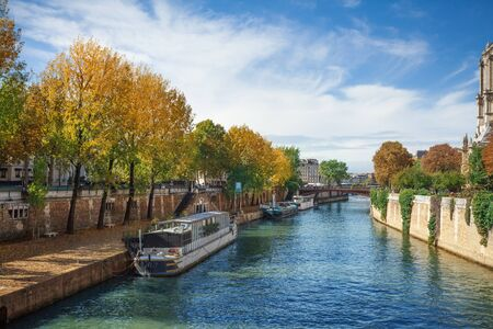notre dame: Seine river embankment near Notre Dame cathedral in Paris Stock Photo