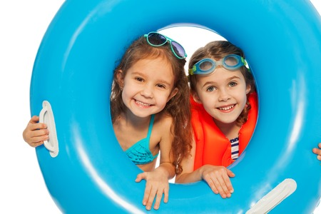 child protection: Two friends looking out the big blue rubber ring isolated on white Stock Photo
