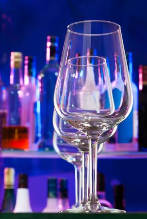 winy: Set of glasses for wine in the row with bar on background