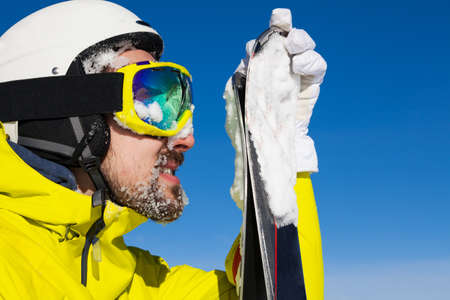 ski mask: Close portrait of man with beard in ski mask and helmet standing over the mountains Stock Photo