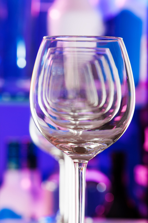 winy: Set of wine glasses standing in a row one after another forming transparent perspective close-up shot