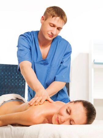 rubdown: Picture of happy beautiful woman and  recreation therapist in massage salon Stock Photo
