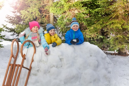 snowballs: Group of kids in snow fortress throw snowballs