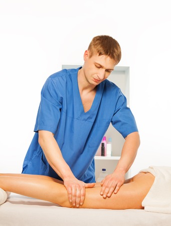 rubdown: Picture of massage specialist doing legs massage in the consulting room