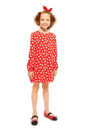 girl in red dress: Whole-length portrait of stylish smiling curly-haired girl in red polka-dot dress, isolated on white background Stock Photo