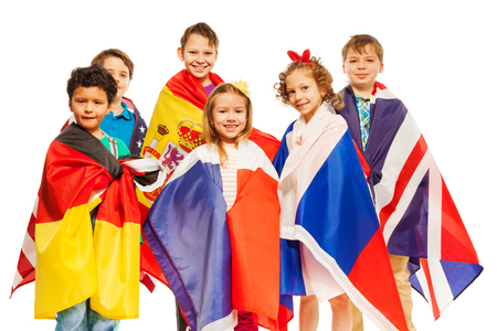 nations: Group of smiling kids wrapped in European nations flags, isolated on white Stock Photo