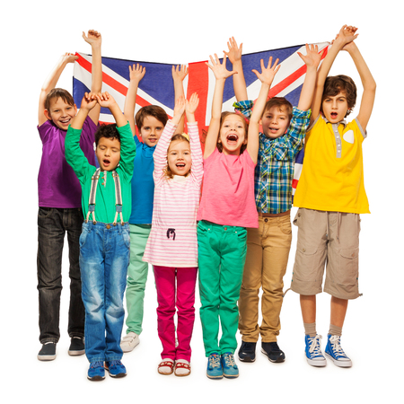 Group of seven happy kids raising their hands up with English flag, isolated on white background 스톡 콘텐츠