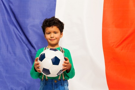 foreign national: Little football fan, boy holding his ball against French flag