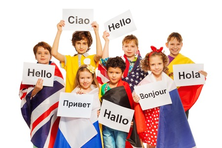 sign language: Kids wrapped in flags of USA and European nations, holding greeting signs in different languages, isolated on white