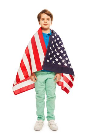 polity: Full length picture of cute boy wrapped in American flag, isolated on white background Stock Photo