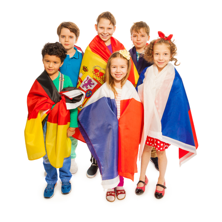 nations: Top view of six kids wrapped in European nations flags, isolated on white background