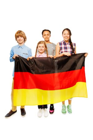 13 15 years: Group of four happy multiethnic teenage kids standing behind the flag of Germany, isolated on white Stock Photo