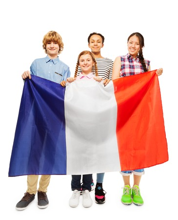 boy 15 year old: Four smiling multiethnic students holding French flag, isolated on white background