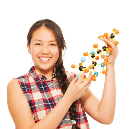13: Smiling Asian teenage schoolgirl examining molecular structure, isolated on white background