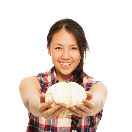 cerebrum: Young smiling Asian girl holding cerebrum model in her hand, isolated on white background