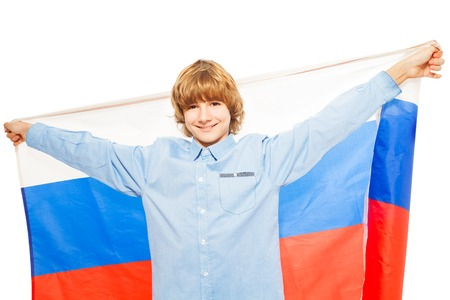 boy 15 year old: Picture of smiling Caucasian boy waving Russian flag, isolated on white background Stock Photo