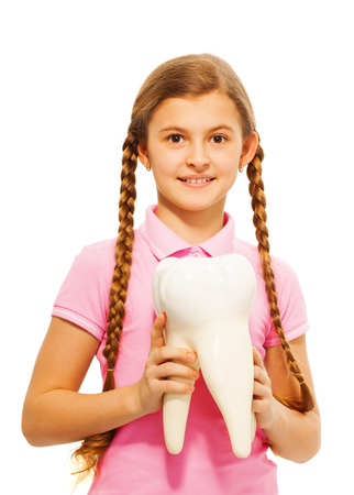 13 15 years: Cute teenager, student or schoolgirl, holding tooth dummy in her hands, isolated on white