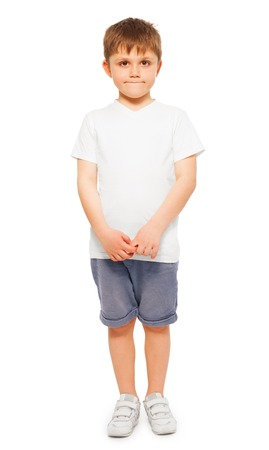 Whole-length picture of little boy wearing blank white t-shirt and denim shorts, isolated on white background Stock Photo