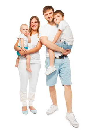 Big happy family, mother and father holding their children, standing in similar t-shirts on white background Stock fotó