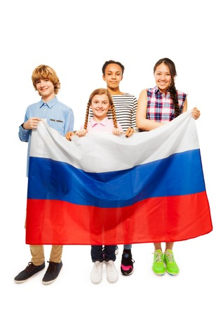 13 year old boy: Group of four happy multiethnic teenage kids standing behind Russian flag, isolated on white