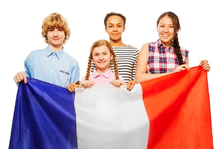 boy 15 year old: Four happy multiethnic students standing behind French flag, isolated on white background