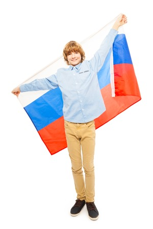 13 year old boy: Teenage blond boy in full height waving Russian flag, isolated on white