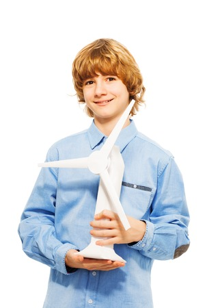 boy 15 year old: Young boy holding model of wind generator turbine, isolated on white background