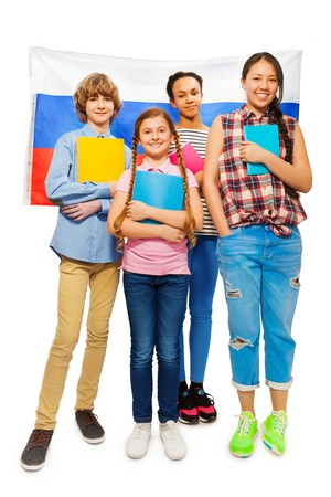 boy 15 year old: Whole-length picture of multi ethnic teenage students standing with textbooks with Russian flag on background, isolated on white Stock Photo