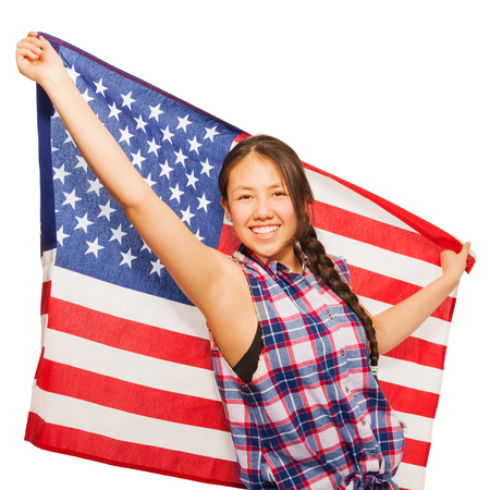 15: Happy Asian teenage girl holds American flag isolated on white background