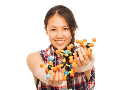 molecular model: Young Asian researcher analyzing a molecular model, isolated on white background Stock Photo