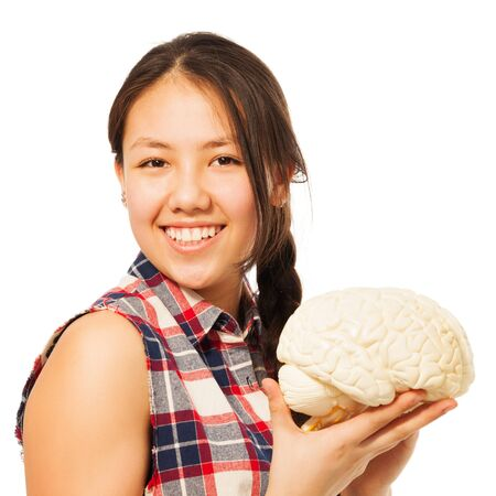 cerebrum: Cute Asian 15 years old girl holding cerebrum model, isolated on white